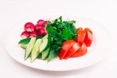 Отрезанные томаты, огурец стоковое фото