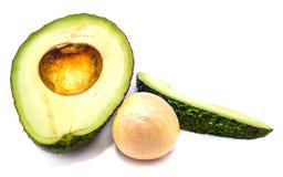 Отрезанный авокадо изолированный на белой предпосылке Стоковое Изображение RF