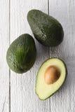 Отрезанный авокадо на белой предпосылке Стоковая Фотография RF