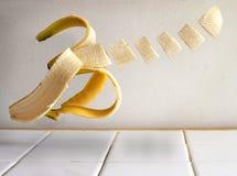 Отрезанный банан летая Стоковые Изображения