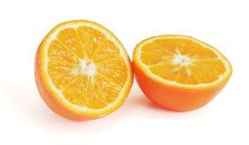 Отрезанный померанцовый плодоовощ на белизне. Стоковое Изображение RF