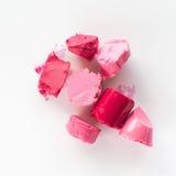 Отрезанный розовый образец губной помады на белой предпосылке Стоковые Фото