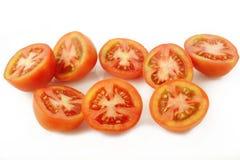 Отрезанный томат на белой предпосылке Стоковые Фото