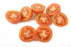 Отрезанный томат на белой предпосылке Стоковое Фото