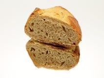 Отрезанный хлеб на зеркале стоковое изображение
