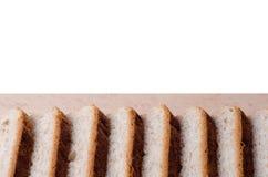 отрезанный хлеб доски Стоковое Изображение