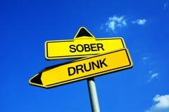Отрезвляйте против пьяного стоковое изображение