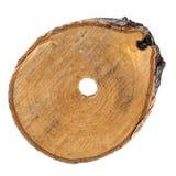 Отрезок березы с отверстием в центре на белизне Стоковые Изображения