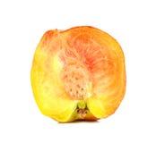 Отрезок персика половинный на белой предпосылке Стоковые Фотографии RF