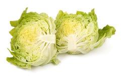 Отрезок пука салата айсберга изолированного на белой предпосылке Стоковая Фотография