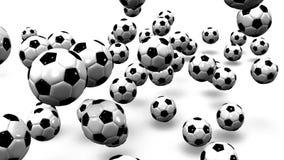 Отскакивать футбольные мячи на белой предпосылке