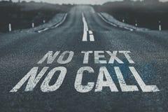 Отсутствие текста отсутствие звонка написанного на дороге Стоковые Изображения