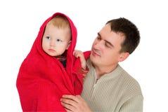 отца красное сынка полотенце совместно вниз Стоковые Изображения RF