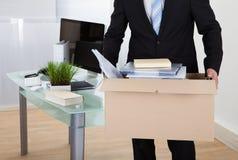 Офисы бизнесмена moving Стоковое фото RF
