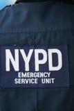 Офицер блока чрезвычайного обслуживани NYPD обеспечивая безопасность на национальном центре тенниса во время США раскрывает 2014 Стоковые Фото