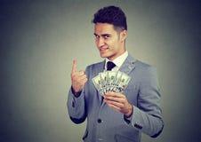 Официально бизнесмен с кучей денег стоковая фотография rf
