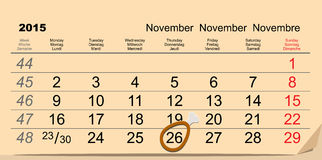 Официальный праздник в США в память первых колонистов Массачусетса 26-ое ноября 2015 Символ ноги цыпленка на календаре иллюстрация штока