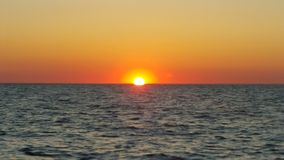 Оффшорный заход солнца Стоковые Фото