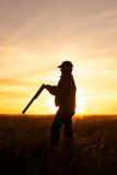 Охотник в заходе солнца Стоковая Фотография