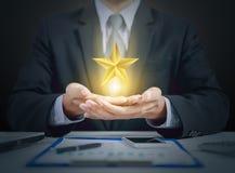 Оценка бизнесмена и звезды, победитель Стоковая Фотография RF