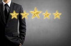 Оценка бизнесмена и звезды, победитель Стоковые Изображения RF