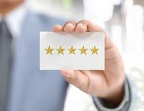 Оценка бизнесмена и звезды Стоковое Изображение RF
