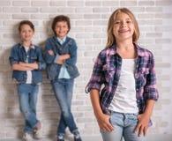 Очаровательные и жизнерадостные дети стоковые изображения