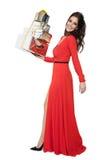 Очаровательная женщина держа много подарков счастливое Новый Год стоковая фотография