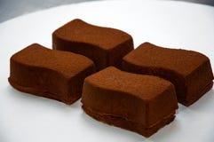 Очень вкусные торты кофе на плите стоковые изображения