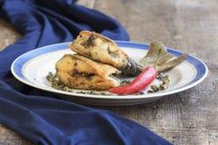 Очень вкусные части зажаренных рыб в плите Стоковые Фото