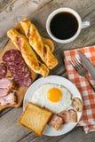 Очень вкусный завтрак с яичками и беконом Стоковая Фотография