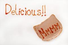 Очень вкусный знак с кетчуп и mmmm на хлебе с pate Стоковые Изображения