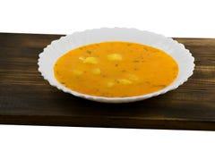 Очень вкусный суп сливк сыра на деревянной доске Суп тыквы стоковое изображение
