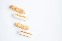 Очень вкусный, чувствительный Eclair с сливк заварного крема и сливк ванили Стоковые Фото