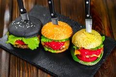 3 очень вкусных бургера Стоковые Фотографии RF