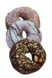 3 очень вкусных donuts встают на сторону - мимо - встают на сторону на белизне Стоковая Фотография