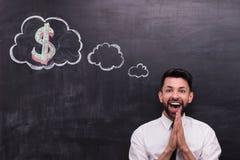 Очень счастливый бизнесмен при знак доллара покрашенный дальше Стоковое Изображение