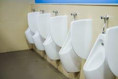 Очистите туалет людей общественный с светом от шарика Стоковая Фотография