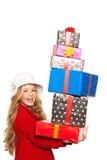 Оягнитесь девушка держа много подарков штабелировано на ее руке Стоковые Фото
