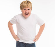 Оягнитесь портрет мальчика студии ребенка сердитый на белизне Стоковые Фото