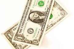 2 доллара США положенного над белизной Стоковые Фото