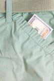 100 долларовых банкнот внутри передних карманных брюк Стоковое фото RF
