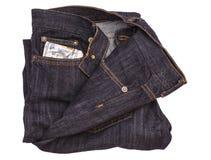 100 долларовых банкнот вставляя из карманн джинсов джинсовой ткани Стоковое Изображение