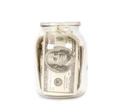 100 долларовых банкнот в стеклянном опарнике Стоковые Фотографии RF