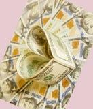 100 долларовых банкнот в форме сердца Стоковые Фотографии RF