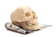 100 долларовых банкнот с человеческим черепом i Стоковое Изображение