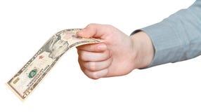 10 долларов банкноты в изолированной руке Стоковая Фотография