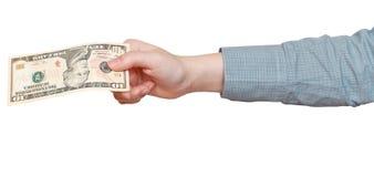 10 долларов банкноты в руке изолированной на белизне Стоковое Изображение