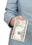 10 долларов банкноты в руке Стоковые Изображения RF
