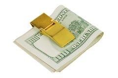 100 долларов банкнот в золотом зажиме денег Стоковые Изображения RF